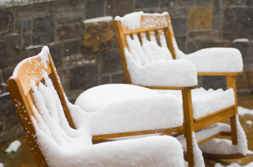 Snow Covered Chairs And Fresh Snow Falling. Outdoor Wood Chairs Covered  With Several Inches Of